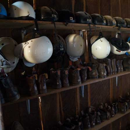 rows of riding helmets and riding boots
